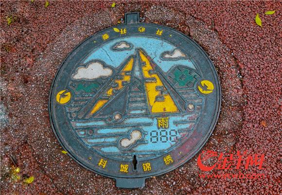 9、印有黄埔元素图标的小电箱和井盖成了绿道上的亮点 陈馥敏摄.jpg